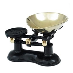 Traditional kitchen scales, black cast iron with brass bowl