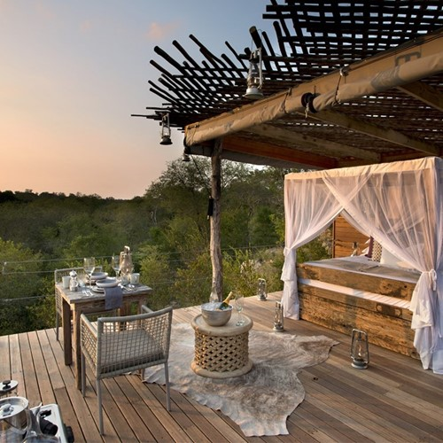 Romantic treetop penthouse South African getaway with safari trek for two